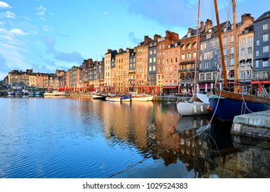 Dawn at the beautiful Honfleur harbor with boats and reflections, Normandy, France