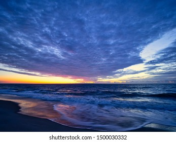 Dawn begins with spectacular clouds and color off the coast of Bethany beach, Delaware.