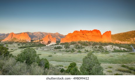 Dawn colors South Gateway, Signature, North Gateway, Kissing Camels, Tower of Babel (named rock formations) in Garden of the Gods, Colorado Springs, Colorado.