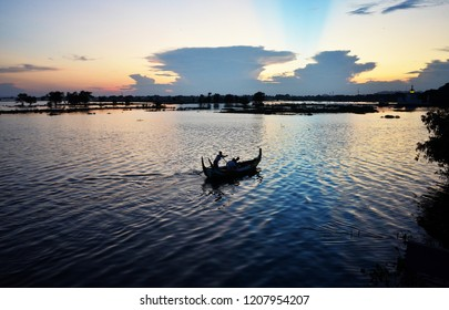The dawn of the day has bright air, there are boats for tourists to float in the lake.