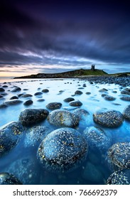 Dawn at Dunstanburgh Castle on the Northumbrian coast