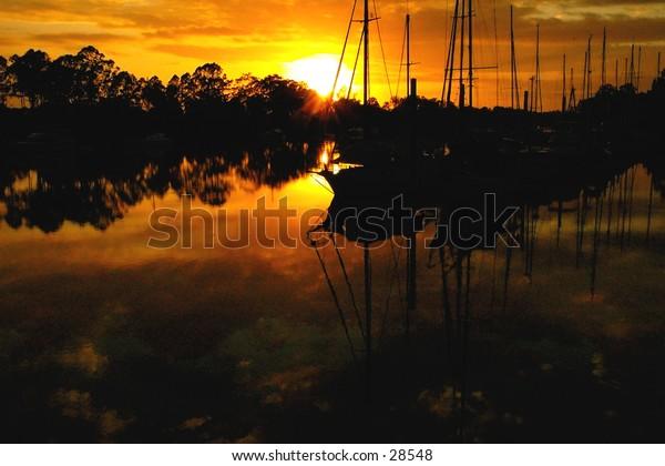 Dawn glow on the river