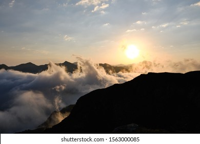 Dawn high in the mountains above the clouds. Arkhyz, Russia