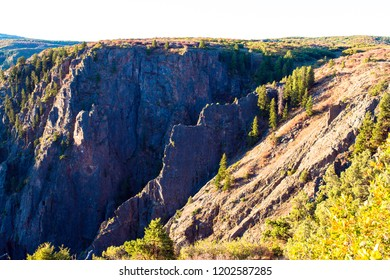 Dawn light hits the edge of Black Canyon of the Gunnison National Park in Colorado