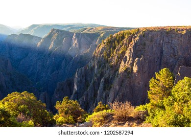 Dawn light hits the top edge of Black Canyon of the Gunnison National Park in Colorado
