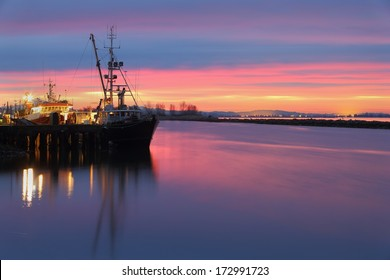 Dawn at the marina in Steveston Harbor, British Columbia, Canada where the commercial fishing fleet prepares to leave the dock. Located at the mouth of the Fraser River near Vancouver.