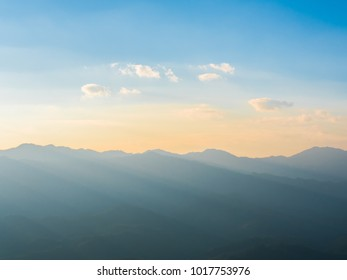 dawn in the mountains with blue sky and cloud