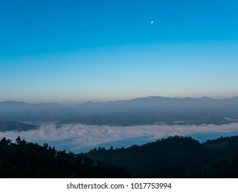dawn in the mountains with blue sky and moon