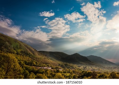 Dawn in the mountains in italy with beautiful sunrays