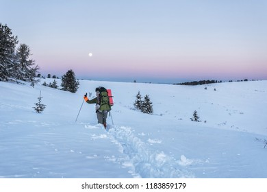Dawn on the Altai in the mountains in winter, ski tourism in the mountains, on the Altai, tourists