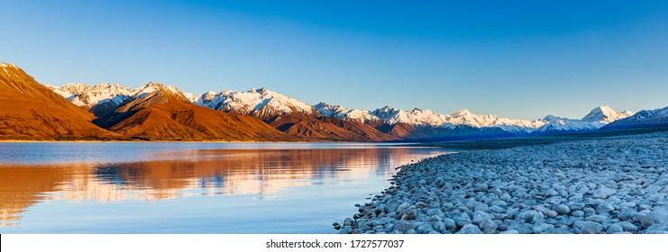 Dawn On Lake Pukaki. Aoraki and The Sourthern Alps At First Light