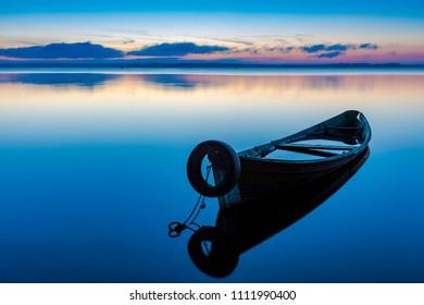 Dawn on lake Seliger with an old fishing boat in the foreground, Ostashkov, Tver region, Russia.