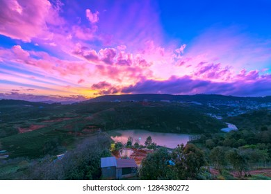 Dawn on plateau in morning with colorful sky, while sun rising from horizon shines down to small village landscape so beautiful idyllic countryside Dalat plateau, Vietnam