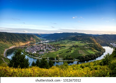 Dawn on the river Moselle in Germany. Bright blue sky at dawn. Panorama of the Moselle river in Germany