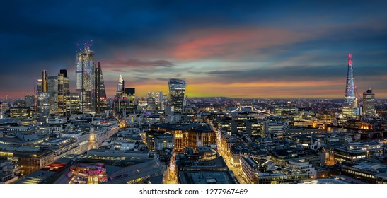 Dawn over the skyline of the City of London, United Kingdom, featuring the modern skyscrapers and Tower Bridge