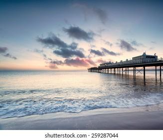 Dawn at the pier on Paignton beach near Torquay in Devon