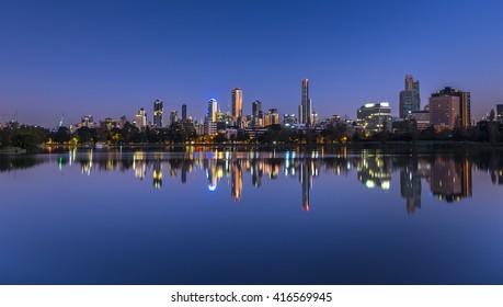 Dawn reflections city skyline Albert park lake Melbourne