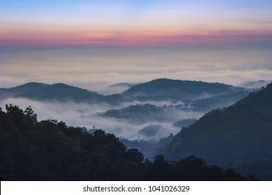 Dawn of Sea Fog on the top of the Sierra at Doi Samer Dao, Nan, Thailand