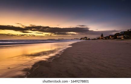 Dawn sky reflections Currumbin beach gold coast Queensland sunrise dramatic ocean surf