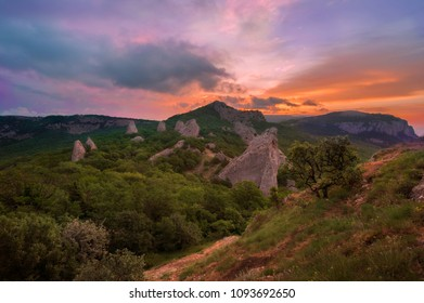Dawn of the sun in the mountains - Temple of the Sun (Tyshlar Rocks) - view from the mountain of Ilyas Kaya in the Crimea near Sevastopol