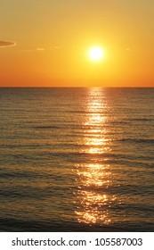 Dawn of the sun on the sea