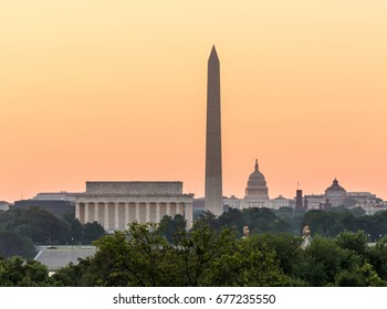 Dawn and sunrise over nations capital with all monuments aligned against orange sky