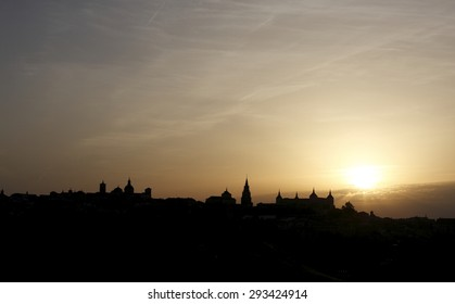 Dawn in Toledo, Castilla La Mancha,Spain, backlit, yellow background and black silhouette sky over the city silhouette view of the main medieval monuments,creative photographs of Munimara,munimara.com
