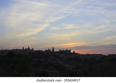 dawn in Toledo, Castilla La Mancha,Spain, backlit, black silhouette sky blue and pink over the city silhouette view of the main medieval monuments,creative photographs of Munimara,munimara.com