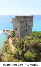Dawn tower Torre aurora in Cinque Terre village Monterosso al Mare and Mediterranean Sea, Italy