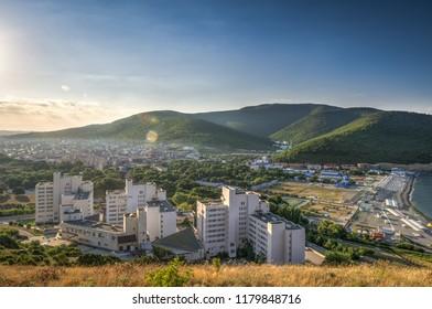 The dawn of urban settlement in the mountains. The village of Sukko, Anapa, Krasnodar region, Russia. Horizontal frame.