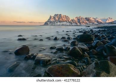 Dawn at Utakleiv Beach, Lofoten Islands, Norway in the winter.