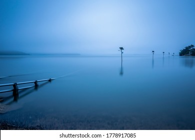 Dawn view of flood tide over streetlamps of a bridge connecting Ungdo Island near Seosan-si, South Korea