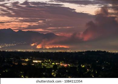 Dawn view of the La Tuna wildfire burning on Verdugo Mountain near Burbank.