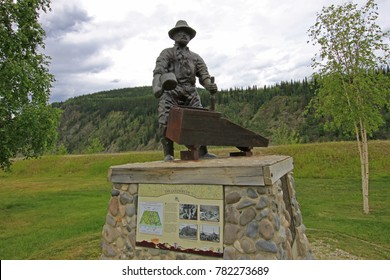 DAWSON CITY, YUKON, CANADA, JUNE 24 2014: The Monument Of Miner George Washington Carmack in Dawson City, Yukon Territory, Canada on June 24, 2014