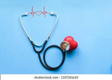 Day of cardiologist, Cardiology, Black stethoscope with red heart and cardiogram on blue background, heart disease, diagnosis of heart disease