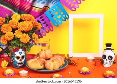 Day of the dead, Dia De Los Muertos Celebration Background With sugar Skull, calaverita, marigolds or cempasuchil flowers, bread of death or Pan de Muerto and empty frame. Traditional Mexican culture
