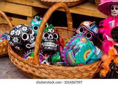 The Day of the Dead El Día de los Muertos in Spanish is a Mexican and Mexican-American celebration of dead ancestors. Contained in a basket multi colored skulls - Queretaro Mexico, 28 Oct 2017