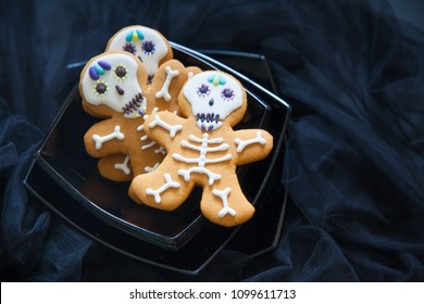 The day of the Dead. Gingerbread. Black background. Glaze on cookies.