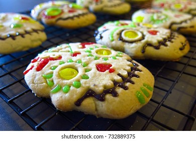 Day of the Dead Halloween skull cookies with colorful icing decoration