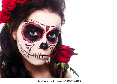 Day of the dead. Halloween. Young woman in day of the dead mask skull face art and rose. Isoleted om white.