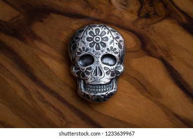 day of the dead skull poured in fine silver as a precious metal collectible