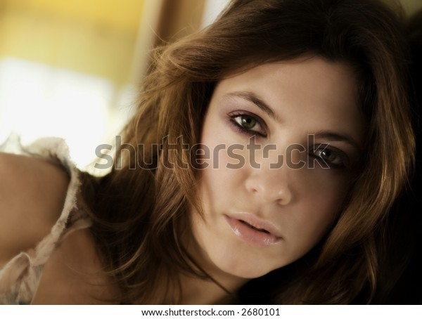 day dreaming: charming woman looking at the camera