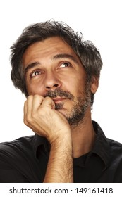 Day dreaming. Portrait of a adult men with a facial expression. Studio shot, isolated on white background.