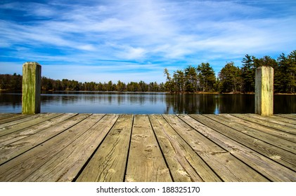 A Day At The Lake. Wooden dock overlooking a gorgeous lake in the wilderness.  Ludington State Park. Ludington, Michigan.