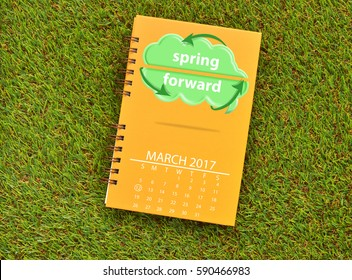 Day Light Savings 12 March 2017 Calendar Green Cloud Arrows Yellow Spiral Notebook on grasss