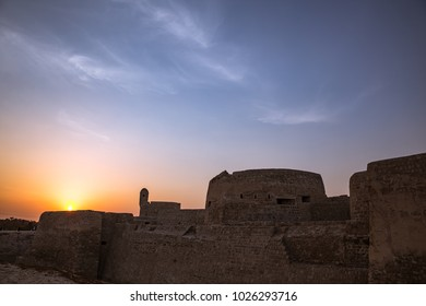 Day meets night over the Bahrain Fort.