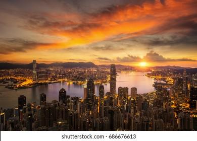 Day to night for Hong kong city sunrise and Hongkong harbor from victoria peak, Hongkong city, China