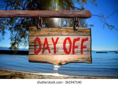 Day off motivational phrase sign on old wood with blurred background
