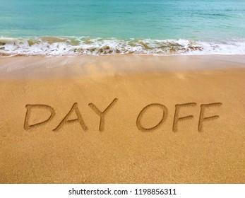 Day off written in the sand on a beautiful Brazilian beach.