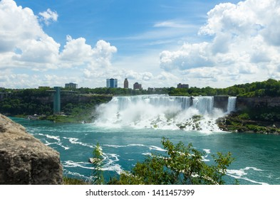 Day shot of the Niagara Falls (American Falls), July 2013, New York State, United States of America. Stunning waterfall with weather (clouds and blue sky). Impressive background.